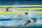 Katie Ledecky (top) of the United States, Ariarne Titmus (middle) of Australia and Emily Overholt (bottom) of Canada compete in the Women's 400m Freestyle Final on day three of the Pan Pacific Swimming Championships at Tokyo Tatsumi International Swimming Center on August 11, 2018 in Tokyo, Japan.