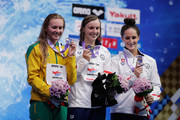 (L to R) Silver medalist Ariarne Titmus of Australia, gold medalist Katie Ledecky of the United States and bronze medalist Leah Smith of the United States pose for photographs on the podium at the medal ceremony for the Women's 400m Freestyle on day three of the Pan Pacific Swimming Championships at Tokyo Tatsumi International Swimming Center on August 11, 2018 in Tokyo, Japan.