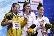 (L to R) Silver medalist Kiah Melverton of Australia, gold medalist Katie Ledecky of the United States and bronze medalist Leah Smith of the United States celebrate on the podium at the medal ceremony for the Women's 1500m Freestyle Timed-Final on day four of the Pan Pacific Swimming Championships at Tokyo Tatsumi International Swimming Center on August 12, 2018 in Tokyo, Japan.