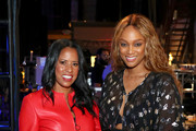 Michelle Ebanks (L) and Tyra Banks pose backstage during the 'Tyra Banks' Trail Blazing Entertainment Ventures - What's Next?: A Phygital Dream Come True' panel at AT&T SHAPE at Warner Bros. Studios on June 22, 2019 in Burbank, California.