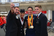 Sarah Storey of the Paralympics GB Team has a selfie taken with members of the British Airways crew as they prepare to fly back from Galeao Airport on British Airways flight BA2016 to Heathrow Airport on September 19, 2016 in Rio de Janeiro, Brazil.