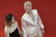 """Tilda Swinton (R) and her daughter Honor Swinton Byrne (L) attend the screening of """"Parasite"""" during the 72nd annual Cannes Film Festival on May 21, 2019 in Cannes, France."""