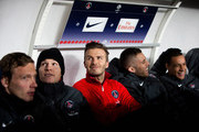 David Beckham (red top) of PSG is pictured on the bench with his new team mates prior to the Ligue 1 match between Paris Saint-Germain FC and Olympique de Marseille at Parc des Princes on February 24, 2013 in Paris, France.
