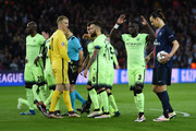 Zlatan Ibrahimovic (1st R) of Paris Saint-Germain prepares for the penalty while Manchester City players protest Referee Milorad Mazic (3rd L) during the UEFA Champions League Quarter Final First Leg match between Paris Saint-Germain and Manchester City at Parc des Princes on April 6, 2016 in Paris, France.