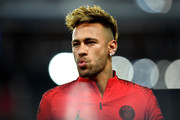 Neymar of Paris Saint-Germain looks on during his warm up prior to the Group C match of the UEFA Champions League between Paris Saint-Germain and SSC Napoli at Parc des Princes on October 24, 2018 in Paris, France.
