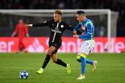 Neymar of Paris Saint-Germain battles for possession with with Jose Callejon of Napoli during the Group C match of the UEFA Champions League between Paris Saint-Germain and SSC Napoli at Parc des Princes on October 24, 2018 in Paris, France.