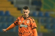 Aaron Ramsey of Juventus in action during the Serie A match between Parma Calcio and Juventus at Stadio Ennio Tardini on December 19, 2020 in Parma, Italy. Sporting stadiums around Italy  remain under strict restrictions due to the Coronavirus Pandemic as Government social distancing laws prohibit fans inside venues resulting in games being played behind closed doors.