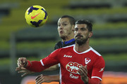Matteo Momente (R) of AS Varese competes for the ball with Djamel Mesbah (L) of Parma FC during the Tim Cup match between Parma FC and AS Varese at Stadio Ennio Tardini on December 3, 2013 in Parma, Italy.