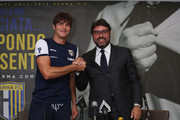 Paolo De Ceglie and Pietro Leonardi attend the press conference of Parma Football Club Unveils New Signing Paolo De Ceglie on September 3, 2014 in Parma, Italy.