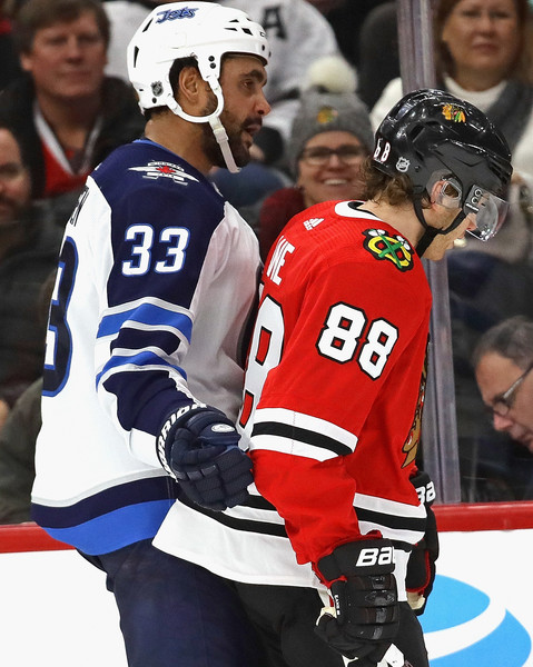 pretty nice f43e9 3cbd1 Patrick Kane and Dustin Byfuglien Photos Photos - Winnipeg ...