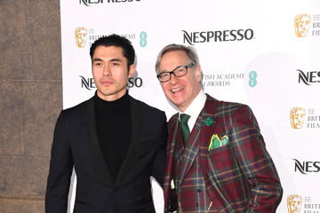 Paul Feig Henry Golding Nespresso British Academy Film Awards Nominees Party - Red Carpet Arrivals