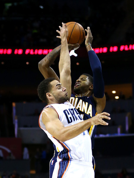 Indiana Pacers v Charlotte Bobcats [photograph,basketball,sports,basketball player,basketball moves,ball game,team sport,player,tournament,sport venue,paul george,user,user,jeff taylor,note,charlotte,indiana pacers,charlotte bobcats,game]