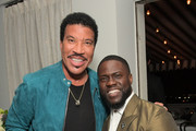 Lionel Richie and Kevin Hart attend the Paul Smith Honors John Legend dinner on May 14, 2019 in Los Angeles, California.
