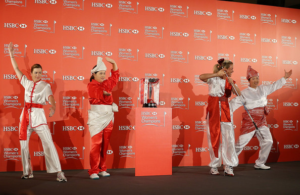 HSBC Women's Champions: Previews [hsbc womens champions - previews,red,stage,font,performance,event,red carpet,advertising,costume,paula creamer,shanshan feng,l-r,pose,usa,singapore,china,norway,photocall]