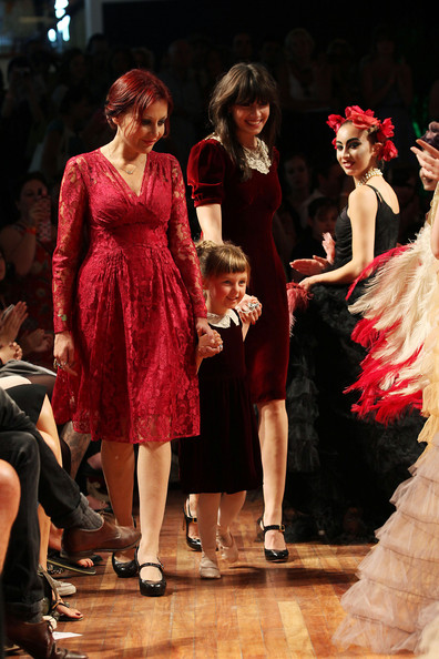 Pearl Lowe (L), Daisy Lowe (3rd L) and models walk the catwalk showcasing designs from a 1920s inspired fashion collection by Pearl Lowe and Daisy Lowe 'Pearl Lowe For Peacocks 2011' during the Vintage At Southbank Centre festival at the Royal Festival Hall on July 31, 2011 in London, England.