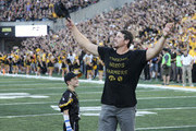 IOWA CITY, IOWA- SEPTEMBER 23:  Former linebacker Chad Greenway of the Iowa Hawkeyes and Minnesota Vikings waves to the fans during the honorary captain announcement before the match-up against the Penn State Nittany Lions on September 23, 2017 at Kinnick Stadium in Iowa City, Iowa.