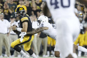 IOWA CITY, IOWA- SEPTEMBER 23:  Quarterback Nate Stanley #4 of the Iowa Hawkeyes is sacked in the fourth quarter by safety Marcus Allen #2 of the Penn State Nittany Lions on September 23, 2017 at Kinnick Stadium in Iowa City, Iowa.