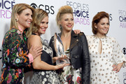 (L-R) Actresses Lori Loughlin, Andrea Barber, Jodie Sweetin and Candace Cameron Bure, winners of the Favorite Premium Comedy Series Award, 'Fuller House', pose in the press room during the People's Choice Awards 2017 at Microsoft Theater on January 18, 2017 in Los Angeles, California.