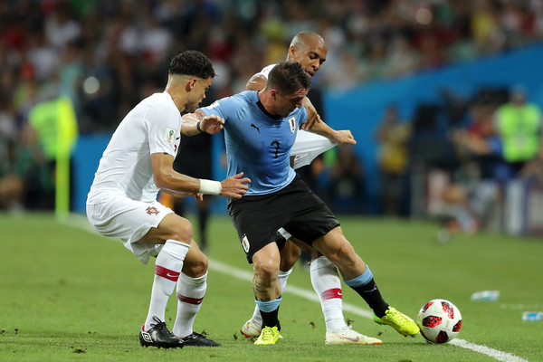 Uruguay v Portugal: Round of 16 - 2018 FIFA World Cup Russia [player,sports,sports equipment,football player,soccer player,team sport,sport venue,ball game,football,soccer,pepe,joao mario,cristian rodriguez,uruguay,portugal,russia,fisht stadium,round,2018 fifa world cup,match]