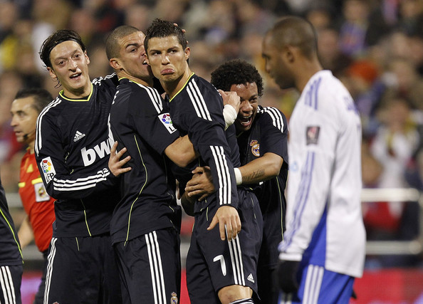 Pepe Cristiano Ronaldo (C) of Real Madrid celebrates with his team mates Pepe, Mezut Ozil (L) and Marcelo VIeira (R) after scoring Real's second goal during the La Liga match between Real Zaragoza and Real Madrid at La Romareda stadium on December 12, 2010 in Zaragoza, Spain.