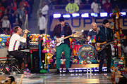 (L-R) Chris Martin, Jonny Buckland, Will Champion and Guy Berryman of Coldplay perform onstage during the Pepsi Super Bowl 50 Halftime Show at Levi's Stadium on February 7, 2016 in Santa Clara, California.