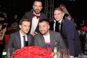 (Back L-R) Michael Maccari, Vincent Panzanella, (Front L-R) Dan Stevens and Michael Fisher attend the 26th annual Elton John AIDS Foundation Academy Awards Viewing Party at The City of West Hollywood Park on March 4, 2018 in West Hollywood, California.