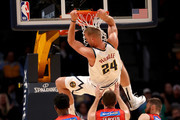 Mason Plumlee #24  of the Denver Nuggets dunks the ball over Terrico White # 23, Tom Jervis #13 and Nick Kay #3 of the Perth Wildcats at the Pepsi Center on October 5, 2018 in Denver, Colorado. NOTE TO USER: User expressly acknowledges and agrees that, by downloading and or using this photograph, User is consenting to the terms and conditions of the Getty Images License Agreement.