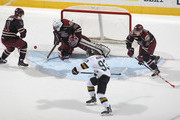 Scott Smith #35 of the Peterborough Petes saves a shot from Mitchell Marner #93 of the London Knights during an OHL game at Budweiser Gardens on December 14, 2014 in London, Ontario, Canada. The Knights defeated the Petes 5-2.