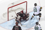 Christian Dvorak #10 of the London Knights slips a shot past Scott Smith #35 of the Peterborough Petes in an OHL game at Budweiser Gardens on December 14, 2014 in London, Ontario, Canada. The Knights defeated the Petes 5-2.