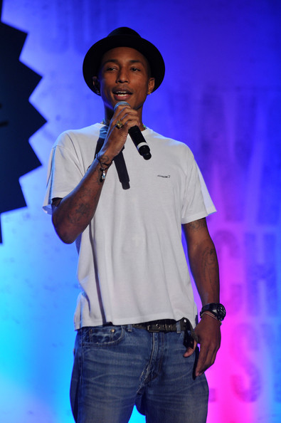 "Pharrell Williams Recording artist Pharrell Williams speaks onstage at ""The Get Schooled National Challenge & Tour"" at Martin Luther King High School on September 24, 2010 in New York City."