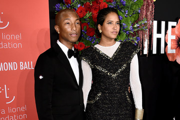 Pharrell Williams Helen Lasichanh Rihanna's 5th Annual Diamond Ball