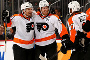 Claude Giroux #28 of the Philadelphia Flyers is congratulated by teammates Kimmo Timonen #44 and Wayne Simmonds #17 after Giroux scored in the third period against the New Jersey Devils at Prudential Center on January 7, 2014  in Newark, New Jersey.The Philadelphia Flyers defeated the New Jersey Devils 3-2 in overtime.
