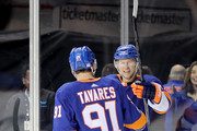 Josh Bailey #12 celebrates with teammate John Tavares #91 of the New York Islanders after scoring the game winning goal in overtime against the Philadelphia Flyers during their game at Barclays Center on November 22, 2017 in the Brooklyn borough of New York City.