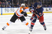 Pierre-Edouard Bellemare #78 of the Philadelphia Flyers checks Emerson Etem #96 of the New York Rangers during the second period at Madison Square Garden on November 28, 2015 in New York City.
