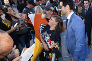 Max Pacioretty (R) #67 of the Vegas Golden Knights poses for photos with fans as he arrives at the team's home opener against the Philadelphia Flyers at T-Mobile Arena on October 04, 2018 in Las Vegas, Nevada.