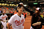 Chris Parmelee #41 of the Baltimore Orioles reacts while getting hit with a pie by Adam Jones #10 following the Orioles 19-3 win over the Philadelphia Phillies Oriole Park at Camden Yards on June 16, 2015 in Baltimore, Maryland.