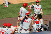 Cameron Rupp #29 of the Philadelphia Phillies celebrates his seventh inning two run home run with Andres Blanco #4 and teammates during the seventh inning against the Colorado Rockies at Coors Field on July 10, 2016 in Denver, Colorado.