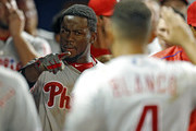 Odubel Herrera #37 celebrates his run with Andres Blanco #4 of the Philadelphia Phillies during the eighth inning of a game against the Philadelphia Phillies at Marlins Park on May 7, 2016 in Miami, Florida.