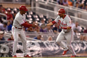 Third base coach Juan Samuel #8 of the Philadelphia Phillies congratulates Andres Blanco #4 on a solo home run against the Minnesota Twins during the third inning of the game on June 22, 2016 at Target Field in Minneapolis, Minnesota. The Twins defeated the Phillies 6-5.