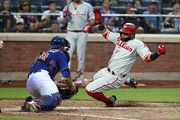 Devin Mesoraco #29 of the New York Mets tags out Carlos Santana #41 of the Philadelphia Phillies in the third inning  during their game at Citi Field on July 10, 2018 in New York City.