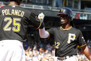 Andrew McCutchen #22 of the Pittsburgh Pirates celebrates with Gregory Polanco #25 after hitting a two run home run in the first inning against the Philadelphia Phillies during the game at PNC Park on July 5, 2014 in Pittsburgh, Pennsylvania.