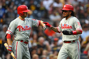 Freddy Galvis #13 celebrates with Daniel Nava #25 of the Philadelphia Phillies after scoring in the third inning against the Pittsburgh Pirates at PNC Park on May 19, 2017 in Pittsburgh, Pennsylvania.