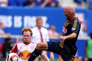 Conor Casey #6 of Philadelphia Union knocks the ball out of bounds before Dax McCarty #11 of New York Red Bulls can get to it during the U.S. Open Cup at Red Bull Arena on July 21, 2015 in Harrison, New Jersey.