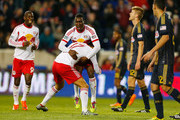 Lloyd Sam #10 of the New York Red Bulls is mobbed by teammates Tim Cahill #17 and Bradley Wright-Phillips #99 after scoring in the 67th minute against the Philadelphia Union at Red Bull Arena on April 16, 2014 in Harrison, New Jersey. Red Bulls defeated the Union 2-1.