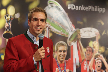 Philipp Lahm Philipp Lahm Hands Over  Championship Trophy To FCB Erlebniswelt