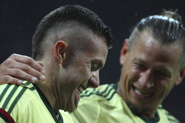 AC Milan v Udinese Calcio  [hair,head,hairstyle,forehead,referee,nose,buzz cut,ear,jaw,ac milan,udinese calcio,serie a,milan,jeremy menez of ac milan celebrates after scoring his second goal with his team,italy,stadio giuseppe meazza,philippe mexes]