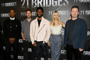 """Stephan James, Taylor Kitsch, Chadwick Boseman, Sienna Miller and Brian Kirk attend the photocall for STX Entertainment's """"21 Bridges"""" at Four Seasons Hotel Los Angeles at Beverly Hills on November 09, 2019 in Los Angeles, California."""