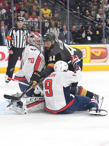 2018 NHL Stanley Cup Final - Game Five [player,college ice hockey,ice hockey position,sports,sports gear,hockey protective equipment,ice hockey,ice hockey equipment,goaltender,team sport,pierre-edouard bellemare,dmitry orlov 9,five,shot,braden holtby 70,t-mobile arena,nhl,vegas golden knights,washington capitals,stanley cup final]