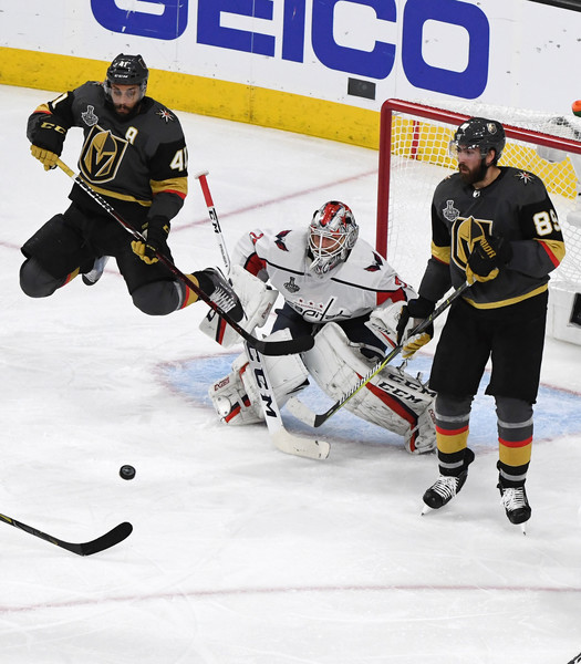 2018 NHL Stanley Cup Final - Game Two [game two,shot,college ice hockey,ice hockey,ice hockey position,sports gear,hockey protective equipment,ice hockey equipment,hockey pants,hockey,ice rink,player,pierre-edouard bellemare,teammate,alex tuch,air,vegas golden knights,nhl,washington capitals,stanley cup final]