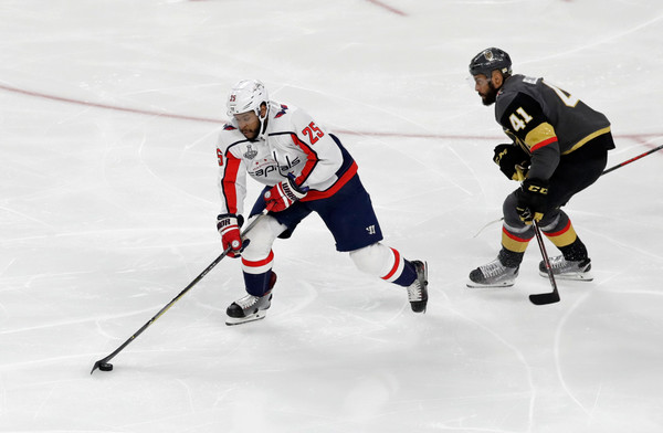 2018 NHL Stanley Cup Final - Game Five [ice hockey,sports,hockey,hockey protective equipment,college ice hockey,team sport,ice hockey position,sports gear,hockey pants,ice rink,devante smith-pelly 25,pierre-edouard bellemare,five,game five,las vegas,nevada,nhl,washington capitals,vegas golden knights,stanley cup final]